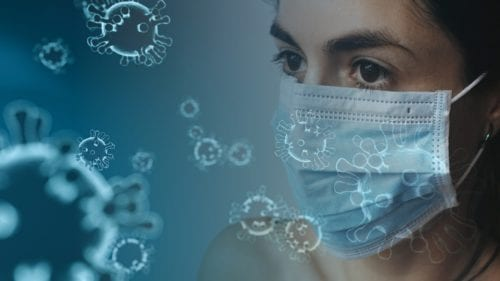 Illustration of a woman wearing a mask with germs floating nearby