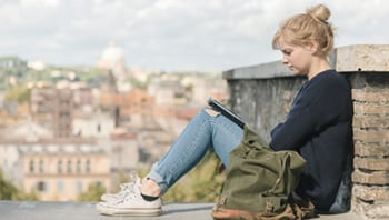 Image of a woman reading her laptop
