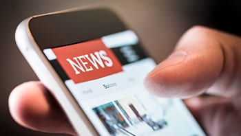 Image of news featured on a mobile phone